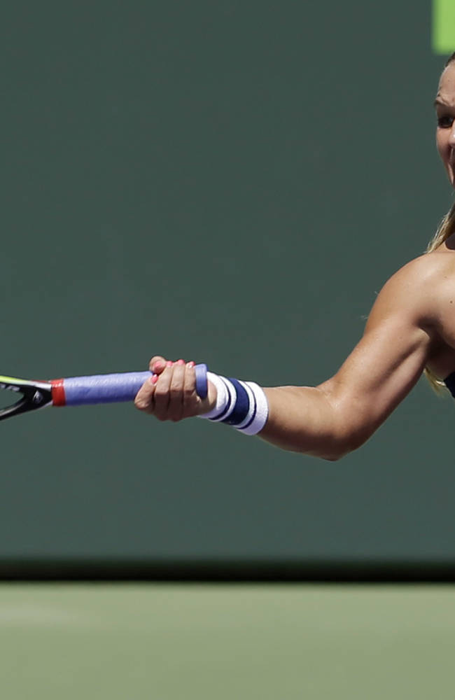 Dominika Cibulkova, of Slovakia, returns to Agnieszka Radwanska, of Poland, at the Sony Open Tennis tournament in Key Biscayne, Fla., Wednesday, March 26, 2014