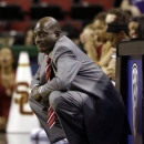 Southern California head coach Michael Cooper looks on in the second half of an NCAA college basketball game against California in the Pac-12 Conference tournament, Friday, March 8, 2013, in Seattle. California defeated Southern California, 78-59. (AP Photo/Ted S. Warren)