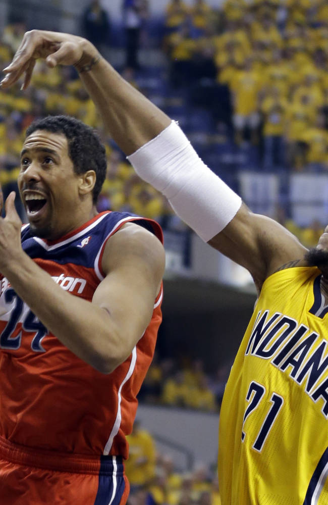 Indiana Pacers forward David West, right, comes from behind to block the shot of Washington Wizards guard Andre Miller during the second quarter of game 1 of the Eastern Conference semifinal NBA basketball playoff series in Indianapolis, Monday, May 5, 2014