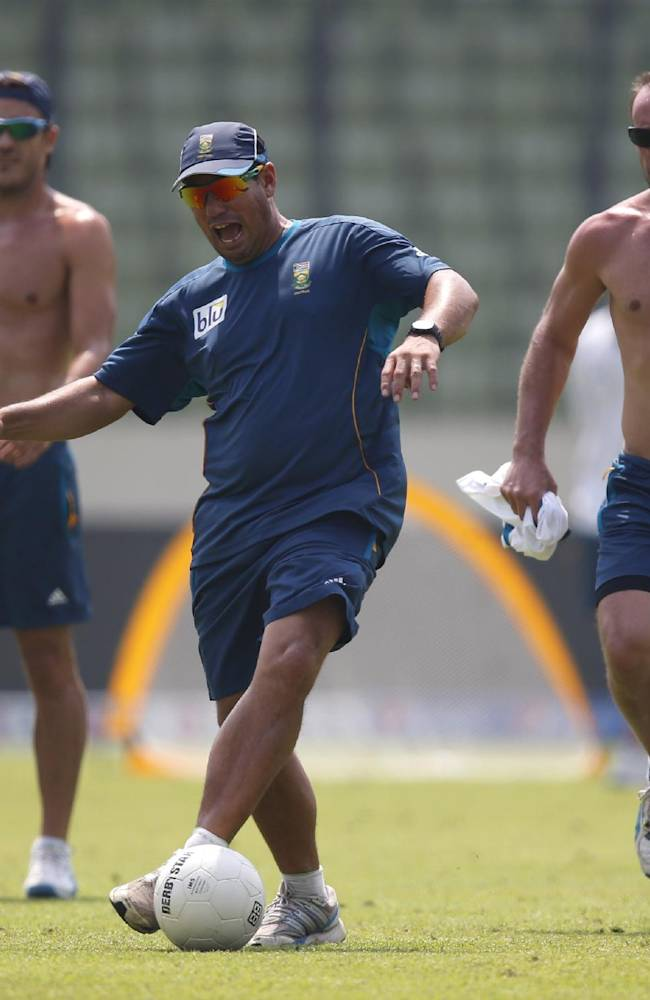 South Africa's team coach Russell Domingo, center, plays a game of soccer with captain Francois du Plessis, left, and AB de Villiers during a training session ahead of their ICC Twenty20 Cricket World Cup semi-final match against India in Dhaka, Bangladesh, Wednesday, April 2, 2014
