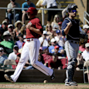 Arizona Diamondbacks' A.J. Pollock, left, scores past Milwaukee Brewers catcher Jonathan Lucroy on a base hit by Gerardo Parra during the second inning of a spring exhibition baseball game in Scottsdale, Ariz., Sunday, March 16, 2014 The Associated Press