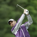 Mathew Goggin, of Australia, tees off on the eighth hole during the first round of the U.S. Open golf tournament at Merion Golf Club, Friday, June 14, 2013, in Ardmore, Pa. (AP Photo/Julio Cortez)