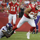 Kansas City Chiefs tight end Anthony Fasano (80) tries to break a tackle by Minnesota Vikings linebacker Jasper Brinkley (54) during the first half of an NFL preseason football game in Kansas City, Mo., Saturday, Aug. 23, 2014 The Associated Press