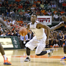 Miami guard Deandre Burnett (1) drives to the basket past Illinois forward/center Nnanna Egwu (32) and guard Kendrick Nunn (25) during the second half of an NCAA college basketball game, Tuesday, Dec. 2, 2014 in Coral Gables, Fla. Miami defeated Illinois 70-61. (AP Photo/Wilfredo Lee)
