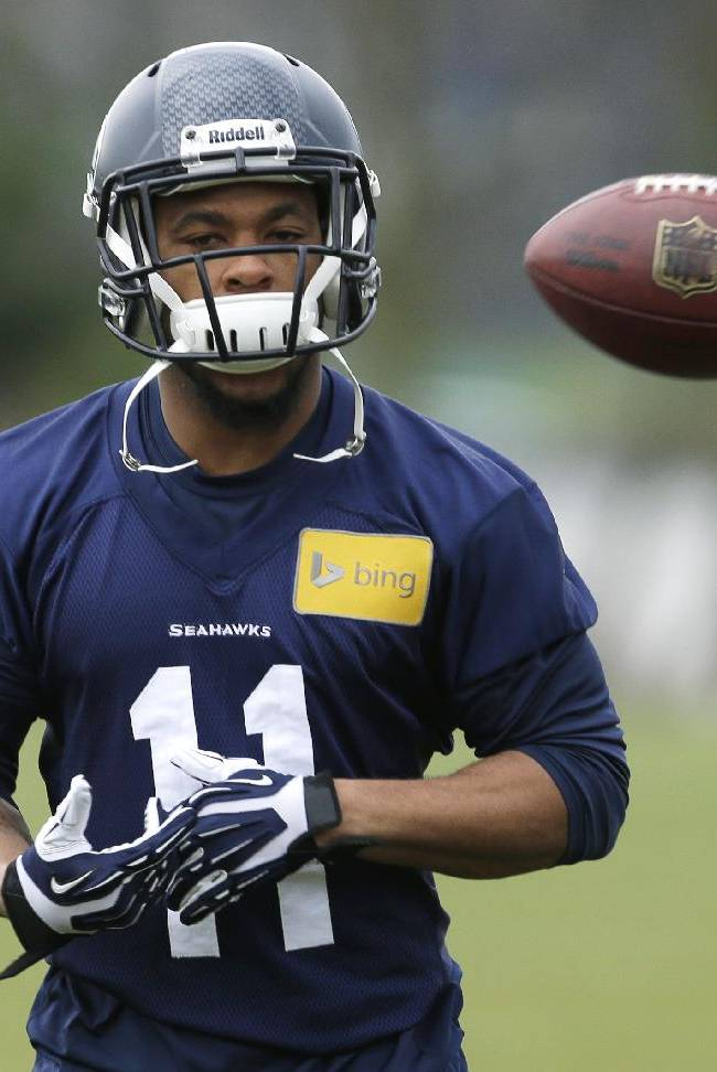 Seattle Seahawks NFL football wide receiver Percy Harvin has a ball tossed to him during stretching warmups on Thursday, Jan. 2, 2014, before practice in Renton, Wash