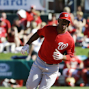 Washington Nationals' Destin Hood rounds second base after hitting a home run to score teammates Mike Fontenot and Jason Martinson in the eighth inning of an exhibition spring training baseball game against the St. Louis Cardinals, Saturday, March 8, 2014
