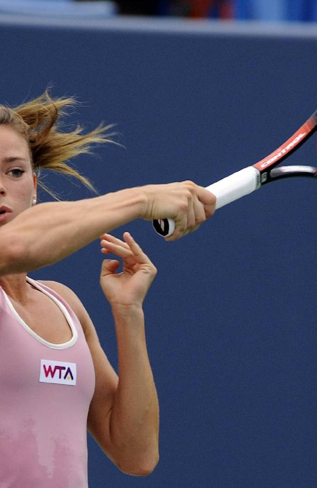 Camila Giorgi, of Italy, hits a forehand during a quarterfinal match against Garbine Muguruza, of Spain, at the New Haven Open tennis tournament in New Haven, Conn., Thursday, Aug. 21, 2014