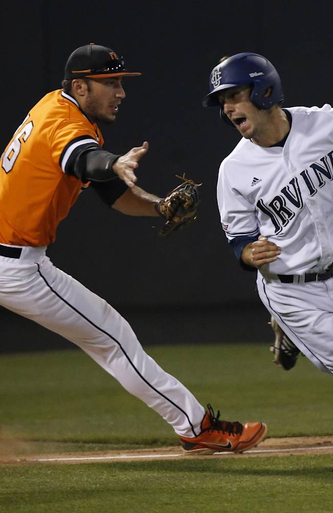 UC Irvine's Justin Castro, right, avoids the tag of Oklahoma State's Tanner Krietemeier, left, after being caught in a run down between third base and home in the second inning of an NCAA college baseball tournament super regional game in Stillwater, Okla., Saturday, June 7, 2014
