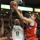 Boston Celtics' Jeff Green (8), center, and Philadelphia 76ers Spencer Hawes (00), right, vie for control of the ball during the first quarter of an NBA preseason basketball game at the TD Garden, in Boston, Sunday, Oct. 21, 2012. (AP Photo/Steven Senne)