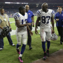 Indianapolis Colts' T.Y. Hilton (13) and teammate Reggie Wayne (87) walk off th field following an NFL football game against the Houston Texans, Thursday, Oct. 9, 2014, in Houston. Indianapolis won 33-28 The Associated Press