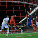 Real Madrid's goalkeeper Iker Casillas clears a cross from Liverpool during the Champions League group B soccer match between Liverpool and Real Madrid at Anfield Stadium, Liverpool, England, Wednesday Oct. 22, 2014