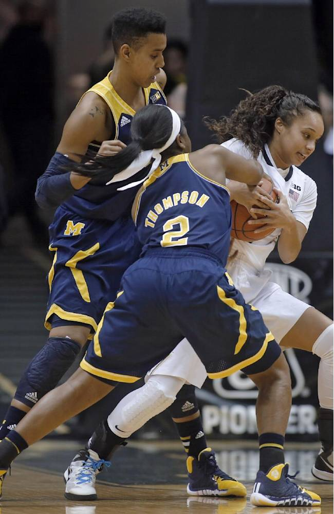 Purdue's KK Houser, right, tussles with Michigan's Siera Thompson (2) for a loose ball during an NCAA college basketball game Wednesday, Jan. 15, 2014, in West Lafayette, Ind