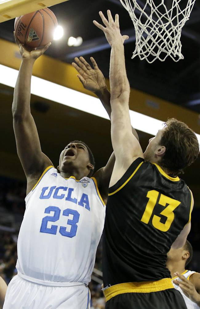 UCLA center Tony Parker, left, scores over Arizona State center Jordan Bachynski during the second half of an NCAA college basketball game in Los Angeles, Sunday, Jan. 12, 2014