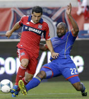 Colorado Rapids defender Marvell Wynne, right, tackles Chicago Fire midfielder Dilly Duka during the first half of an MLS soccer match in Bridgeview, Ill., Wednesday, June 19, 2013. (AP Photo/Nam Y. Huh)