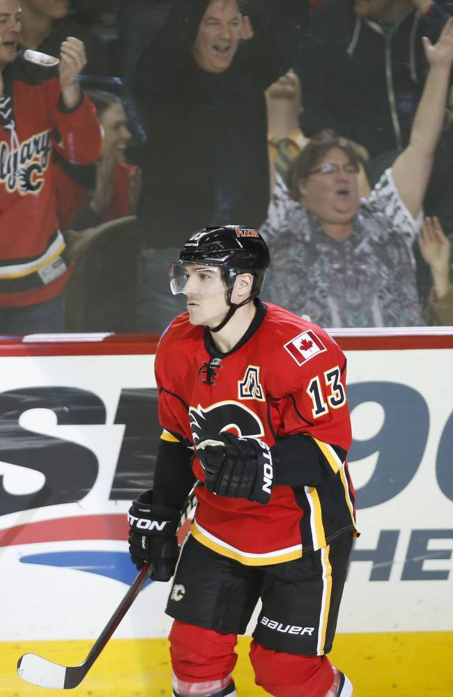 Calgary Flames' Mike Cammalleri reacts to scoring the winning shootout goal during overtime NHL hockey action against the San Jose Sharks in Calgary, Monday, March 24, 2014. The Flames beat the Sharks 2-1 in a shootout