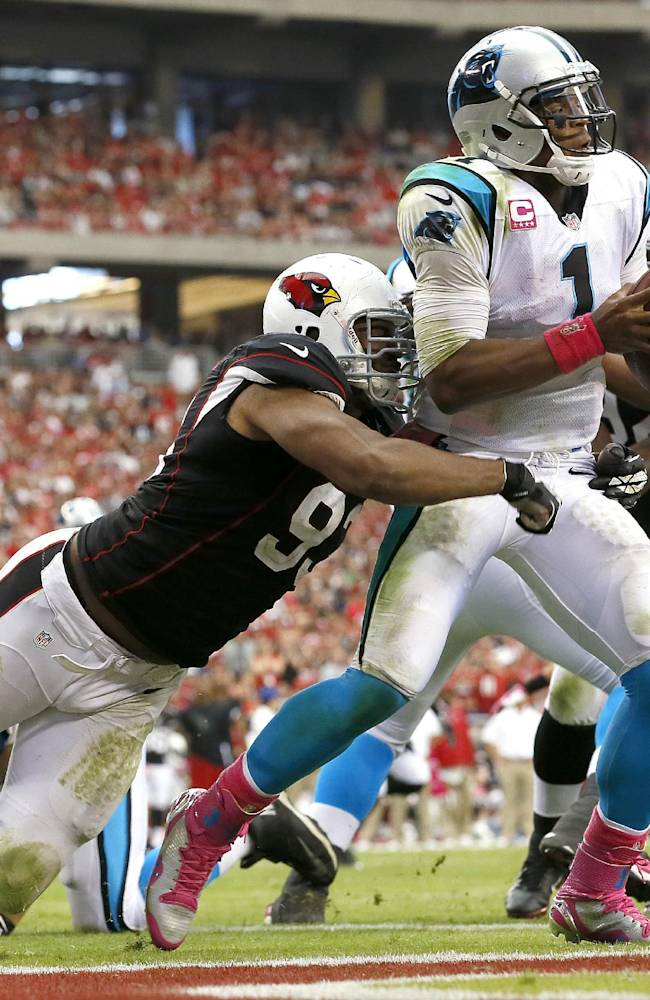 Carolina Panthers quarterback Cam Newton (1) is sacked in the end zone for a safety by Arizona Cardinals defensive end Calais Campbell (93) during the second half of a NFL football game, Sunday, Oct. 6, 2013, in Glendale, Ariz