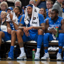 In this photo taken Thursday, Jan. 29, 2015, Kentucky's Willie Cauley-Stein, center, sits on the bench with a towel on his head during the first half of an NCAA college basketball game against Missouri in Columbia, Mo. Cauley-Stein should be easy to find. Just look for the 7-footer with arms covered in tattoos and a decent outside shot. Lately, though, the national player of the year candidate has virtually disappeared.(AP Photo/L.G. Patterson)