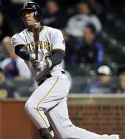 Pittsburgh Pirates' Starling Marte hits a two-RBI triple against the Chicago Cubs during the third inning of a baseball game, Monday, Sept. 17, 2012, in Chicago. (AP Photo/Jim Prisching)