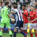 Tempers flare between Cardiff's Craig Bellamy, right, and West Brom goalkeeper Ben Foster, left, after the final whistle during the English Premier League soccer match between West Bromwich Albion and Cardiff City at Hawthorns Stadium in West Bromwich, En