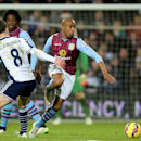 Aston Villa's Fabian Delph, right, battles for the ball with West Bromwich Albion's Craig Gardner during the English Premier League match at the Hawthorns, West Bromwich, England, Saturday Dec. 13, 2014. (AP Photo / Martin Rickett, PA)