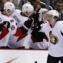 Ottawa Senators' Mark Stone (61) celebrates his goal with teammates as he returns to the bench in the second period of an NHL hockey game against the Pittsburgh Penguins in Pittsburgh, Sunday, April 13, 2014 The Associated Press