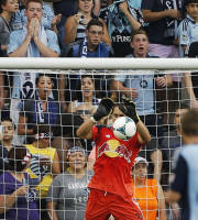 New York Red Bulls goalkeeper Luis Robles (31) makes a save during the first half of an MLS soccer match against Sporting Kansas City in Kansas City, Kan., Saturday, Aug. 3, 2013. (AP Photo/Orlin Wagner)