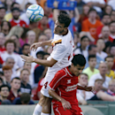 AS Roma midfielder Alessandro Florenzi (24) goes up for the ball against Liverpool FC midfielder Philippe Coutinho, below, during a friendly soccer match at Fenway Park in Boston, Wednesday, July 23, 2014. (AP Photo)
