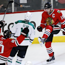 Chicago Blackhawks center Jonathan Toews (19) celebrates his goal against the Dallas Stars during the third period of an NHL hockey game on Sunday, Nov. 16, 2014, in Chicago. The Chicago Blackhawks won 6-2 The Associated Press