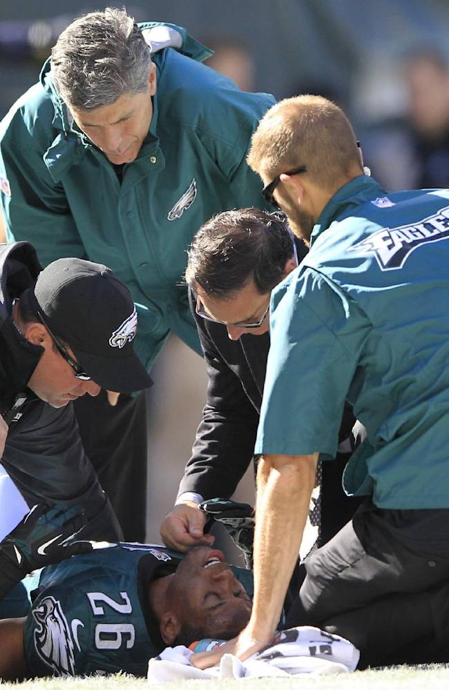 Trainers check on Philadelphia Eagles' Cary Williams (26) after he was injured during the first half of an NFL football game against the New York Giants Sunday, Oct. 27, 2013, in Philadelphia