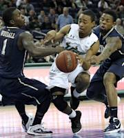South Florida guard Anthony Collins, center, loses the ball as he is sandwiched by Pittsburgh guard Tray Woodall, left, and forward Nasir Robinson, right, during the first half of an NCAA college basketball game on Wednesday, Feb. 8, 2012, in Tampa, Fla. (AP Photo/Chris O'Meara)