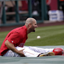 Los Angeles Angels' Albert Pujols laughs while watching batting practice before a baseball game against the New York Mets on Saturday, April 12, 2014, in Anaheim, Calif The Associated Press