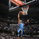 MEMPHIS, TN - DECEMBER 11: Russell Westbrook #0 of the Oklahoma City Thunder goes up for the layup against the Memphis Grizzlies on December 11, 2013 at FedExForum in Memphis, Tennessee. (Photo by Joe Murphy/NBAE via Getty Images)
