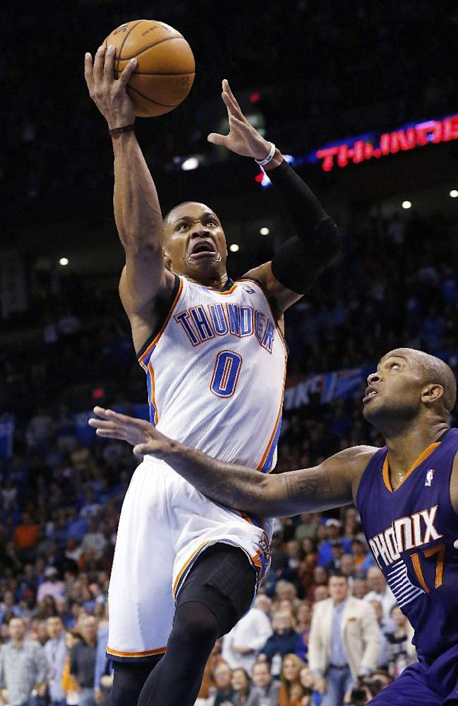 Oklahoma City Thunder guard Russell Westbrook (0) shoots in front of Phoenix Suns forward P.J. Tucker in the fourth quarter of an NBA basketball game in Oklahoma City, Sunday, Nov. 3, 2013. Oklahoma City won 103-96