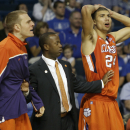 Clemson players Jonah Baize, left, Milton Jennings (24) and assistant coach Earl Grant react to a call by an official that went against them during the second half of an East Regional second round NCAA tournament college basketball game against West Virginia in Tampa, Fla., Thursday, March 17, 2011. West Virginia won 84-76. (AP Photo/John Raoux)