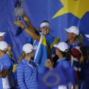Europe's Anna Nordqvist from Sweden holds the Solheim Cup trophy as she and Team Europe celebrate their victory at closing ceremonies for the Solheim Cup golf tournament Sunday, Aug. 18, 2013, in Parker, Colo. Team Europe defeated Team USA 18-10 and retained the Solheim Cup.(AP Photo/David Zalubowski)