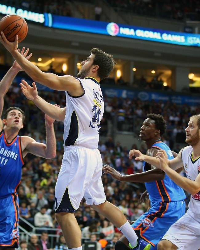 The NBA team Oklahoma City Thunder's Nick Collison, left,  and Melih Mahmutoglu of  Fenerbahce Ulker, centre left, fight for the ball during a preseason basketball game in Istanbul, Turkey, Saturday, Oct. 5, 2-13. Oklahoma City Thunder has opened the preseason schedule with a game against five-time Turkish champion at the Ulker Sports Arena. (AP Photo)