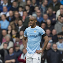 Manchester City's Vincent Kompany holds his hands on his hips after Liverpool's winning goal during their English Premier League soccer match at Anfield Stadium, Liverpool, England, Sunday April 13, 2014