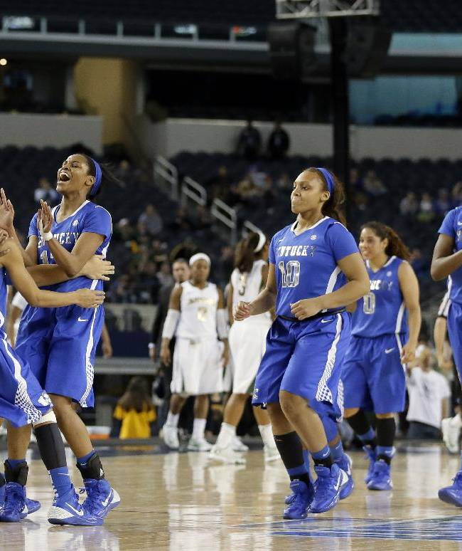 Kentucky's Linnae Harper (15), Kastine Evans (32), second from left, Bria Goss, Bernisha Pinkett (10) and DeNesha Stallworth (11) celebrate their 133-130 in in four overtimes against Baylor in an NCAA college basketball game on Friday, Dec. 6, 2013, in Arlington, Texas