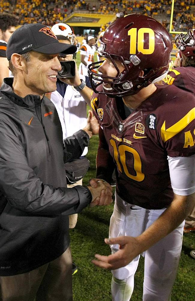 Oregon State Beavers head coach Mike Riley talks to Arizona State quarterback Taylor Kelly (10) after an NCAA college football game on Saturday, Nov. 16, 2013, in Tempe, Ariz. The Sun Devils defeated the Beavers 30-17