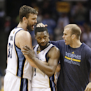 Memphis Grizzlies guard Tony Allen, center, is congratulated by Marc Gasol, left, and Nick Calathes, right, after Allen scored against the Miami Heat in the second half of an NBA basketball game Wednesday, April 9, 2014, in Memphis, Tenn. The Grizzlies wo