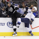 Los Angeles Kings defenseman Jake Muzzin, left, checks St. Louis Blues center Vladimir Sobotka during the first period of an NHL hockey game in Los Angeles, Monday, Dec. 2, 2013 The Associated Press