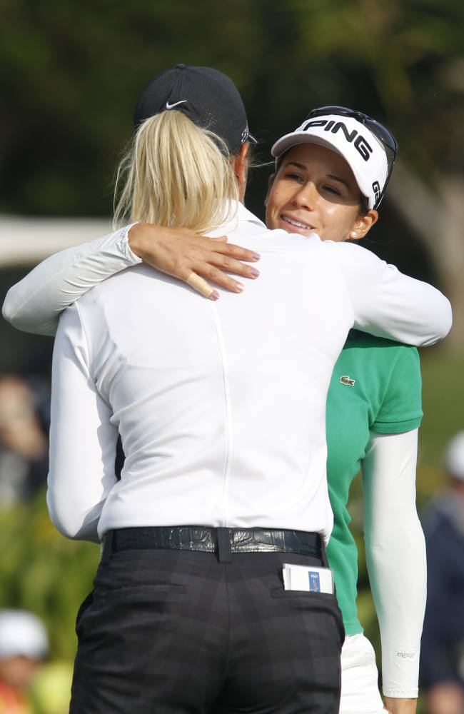 Azahara Munoz, right, of Spain hugs Suzann Pettersen of Norway after completing her play in the LPGA Taiwan Championship tournament at the Sunrise Golf & Country Club, Sunday, Oct. 27, 2013, in Yangmei, northern Taiwan. Petterson won the tournament ahead of Munoz