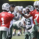 New York Jets quarterbacks Michael Vick (1) and Geno Smith (7) fist bump at the Jets NFL football training camp Thursday, July 24, 2014, in Cortland, N.Y. (AP Photo) The Associated Press