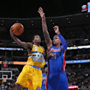 Denver Nuggets guard Aaron Brooks, left, drives for shot as Detroit Pistons forward Charlie Villanueva covers in the fourth quarter of the Nuggets' 118-109 victory in an NBA basketball game in Denver on Wednesday, March 19, 2014 The Associated Press
