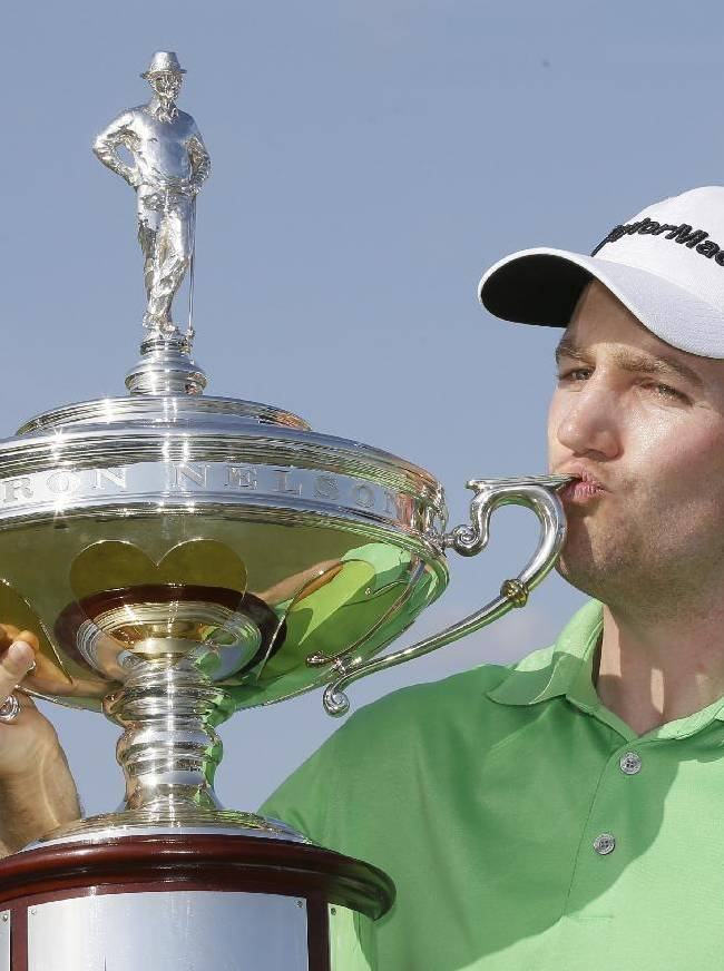 Brendon Todd kisses the trophy after winning the Byron Nelson Championship golf tournament, Sunday, May 18, 2014, in Irving, Texas. (AP Photo/Tony Gutierrez)