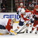 Florida Panthers goalie Roberto Luongo (1) stops Detroit Red Wings right wing Tomas Jurco (26) shot as Florida Panthers defenseman Aaron Ekblad (5) defends in the second period during an NHL hockey game in Detroit Tuesday, Dec. 2, 2014 The Associated Pre