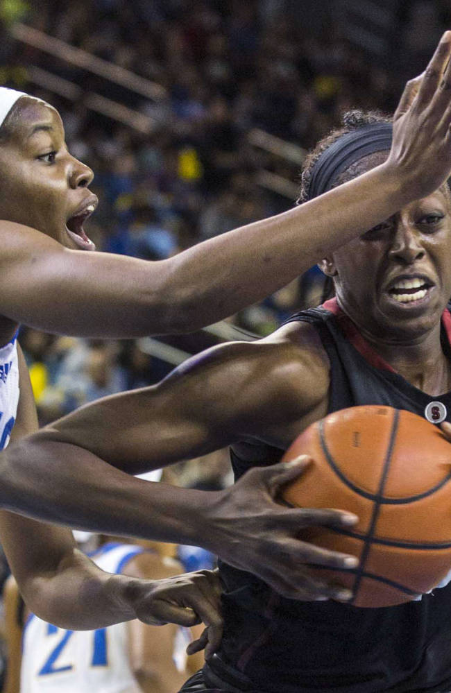 Stanford forward Chiney Ogwumike, right, drives past UCLA center Luiana Livulo, left, in the first half of an NCAA college basketball game, Sunday, Feb. 23, 2014 in Los Angeles