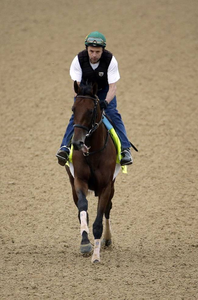 Exercise rider Simon Paine takes Kentucky Derby hopeful Samraat for a morning workout at Churchill Downs Wednesday, April 30, 2014, in Louisville, Ky