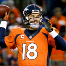 Denver Broncos quarterback Peyton Manning throws against the Indianapolis Colts during the second half of an NFL divisional playoff football game, Sunday, Jan. 11, 2015, in Denver. (AP Photo/Jack Dempsey)