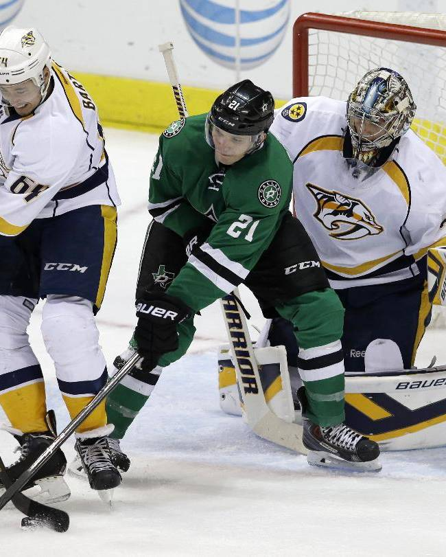 Nashville Predators' Victor Bartley (64)stops a shot as he helps Pekka Rinne (35) of Finland defend the net against pressure from Dallas Stars' Antoine Roussel (21) of France in the second period of an NHL hockey game, Friday, March 28, 2014, in Dallas